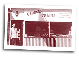George in front of his original storefront